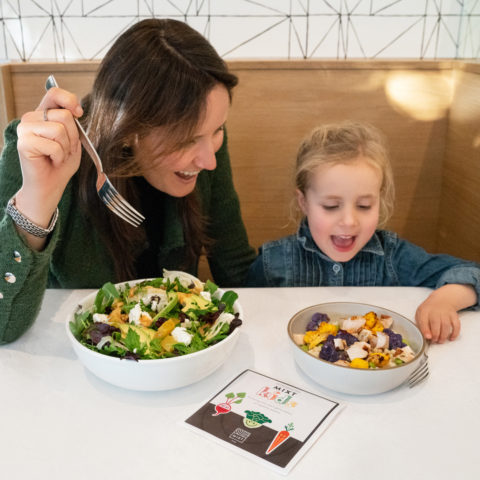 Child and Adult eating Salad